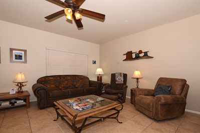 Living room with Queen Sofa sleeper, Glider Chair and Leather Recliner