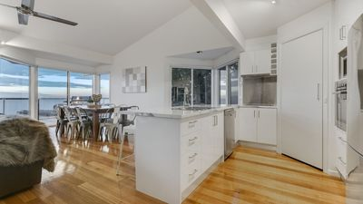 Well-appointed kitchen sharing stunning views with open-plan living