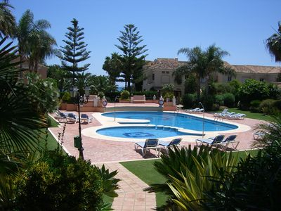 Photo for Townhouse in Marbella, first line of the beach. Golf & Family