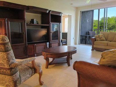 Photo for Relax In The Sunshine! Lovely 2B/2B Vacation Condo w/ All Weather Lanai, Walk To Beach, Resort Pool!