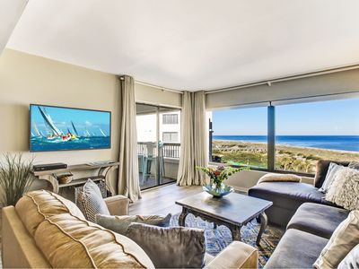 Photo for Immaculate Surf & Racquet Club OCEANFRONT condo steps from the Ritz Carlton!