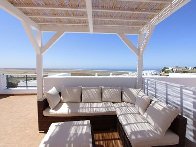 Photo for Casa Feliz - Modern terraced house with fantastic sea views and communal pool