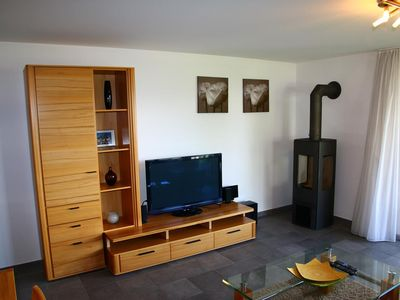 Photo for 5* luxury 3-room-apartment for 6 people located near the (ski)lift.  Modern living room with firepla