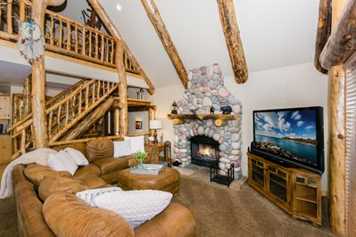 Beautiful Great Room with Real Wood Fireplace - View of the Game Loft