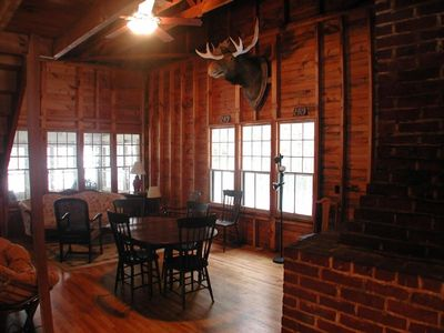 Dining and Living Rooms with chimney and woodstove
