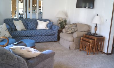 "Spacious Living Room with a 55"" Smart TV and BluRay DVD & a Queen Sofa/Sleeper"