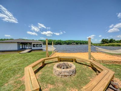 Photo for NEW LISTING! Lakefront home w/ stunning views, firepit, private movie cinema
