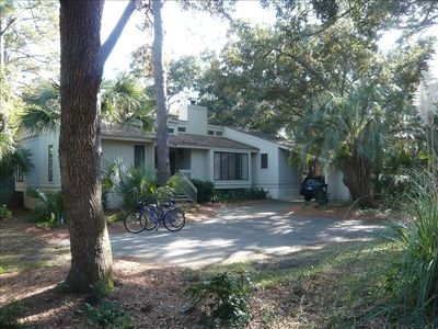 House and deck shaded by beautiful live oak trees
