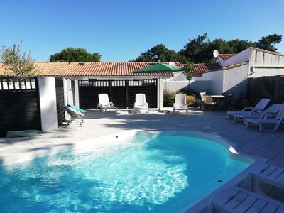 Photo for studio type cottage for 2 persons, private patio and heated pool