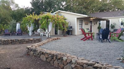 grapevine wrapped trellis,  BBQ, bathroom, fire pit &  2 double chaise lounges
