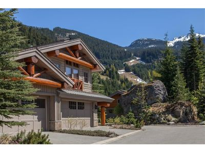Exterior of our home in the Spring.  Peak to Creek ski run in background