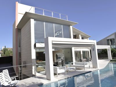 Photo for Design villa, with pool and views