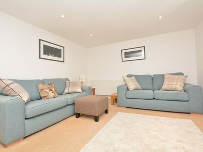 Relax on the comfortable sofas in the lounge