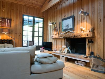 Photo for Charming log cabin, very quiet, at the foot of the dunes