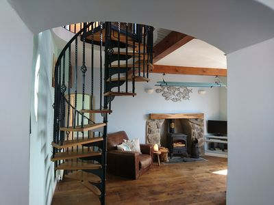 Sitting room and  spiral staircase.