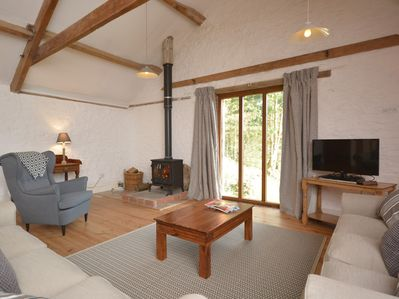Lounge with beautiful views and cosy woodburner