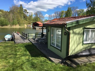 Photo for Lake cottage on our private wooden pier in Kyrkviken
