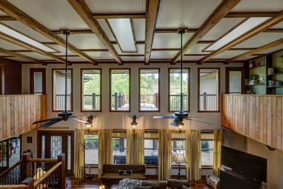 Windows galore! Sit on the balcony overlooking the yard for a birds eye view!