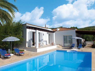 Photo for Spacious villa surrounded by exotic palm trees and amazing views of countryside and sea