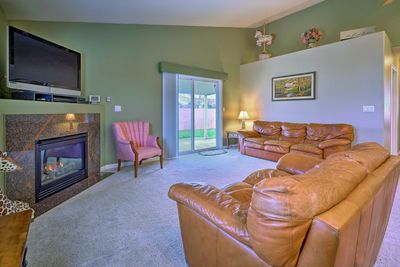 Up to 6 lucky guests can enjoy watching TV near the cozy electric fireplace.