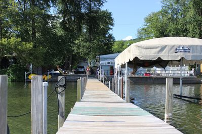 View from end of dock toward cottage.  Kayak's on left are available for you!