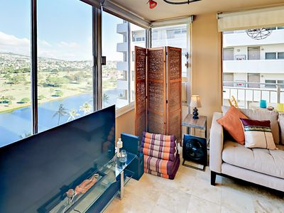 Living Area - Enjoy breathtaking views of the Ala Wai Canal and the mountains beyond.
