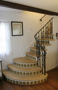 The tiled staircase is a focal point in the living room