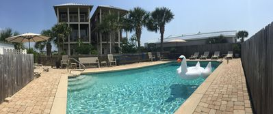 Photo for 4BR/4BA vacation home with private pool & Gulf views – 30-second walk to beach