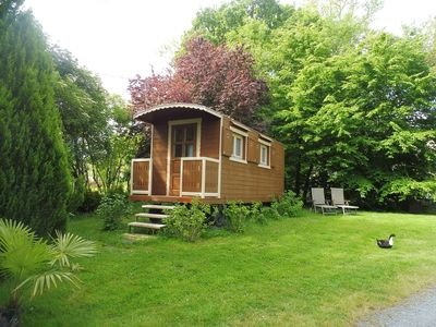 Photo for Bed and Breakfast in a trailer at the edge of a fishing pond, swimming pool, petanque.