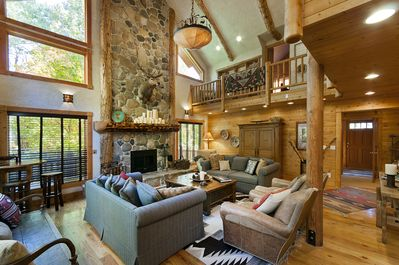 Classic lodge great room with wood-burning fireplace