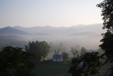 Morning mist hangs in valley (from porch)