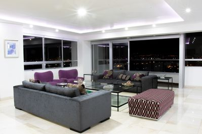 Living room with an incredible view during the day and magical at night.