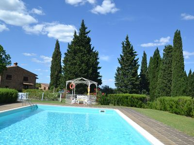 Photo for Apartment in beautiful farmhouse with pool in the heart of Tuscany