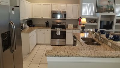 Photo for special low rates 3BED POOL GAME ROOM GRANITE, WIFI GATED MINS FROM DISNEY