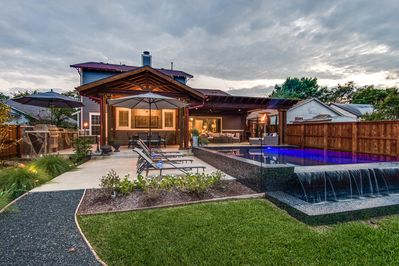 Extraordinary outdoor space with an Infinity pool, covered living & dining rooms