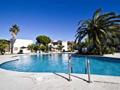 Photo for PUNTA PRIMA 3 with communal pool, beach at 100m