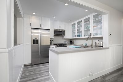 Recently remodeled kitchen with Bosch appliances and grey quartz countertops