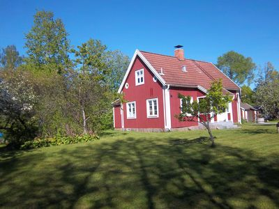 Sailor house red holiday home near lake and golf course with boat in village location