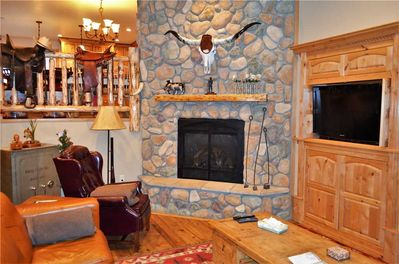 Living Room Area with Warm, Cozy Fireplace
