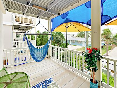 Master Balcony - Chill on hammock chairs and a bistro table for 2 on the master balcony.