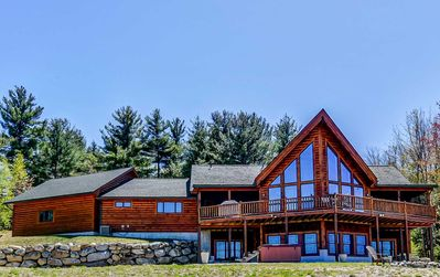Amazing log home with hot tub close to it all!