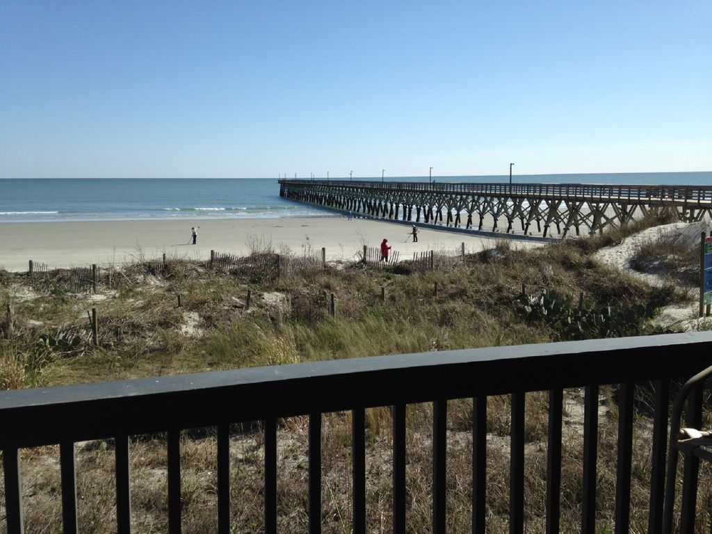 Oceanfront condo with pier access sleeps 4 home away for Pier home