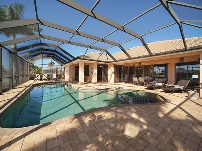 Photo for Pool / Jacuzzi / Free WiFi / BBQ / Kayak / Paddle board / Dock / 5 TV / Waterfront