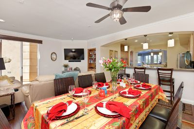 Our dining room table comfortably seats eight people.  Our breakfast bars seat 5