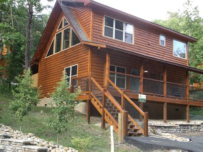 Photo for 2 br cabin with private hot tub and community pools