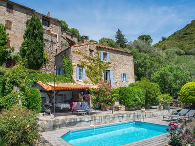 Photo for An authentic stone house, pool, beautiful garden and stunning views