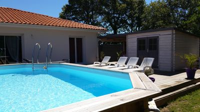Photo for T4 100 m2 new house with heated pool in quiet forest edge