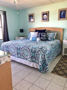 Master Bedroom- King Bed and view of Ocean and Pool. Super comfy bed. TV
