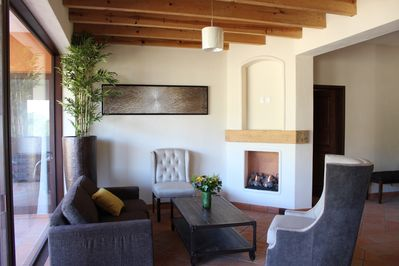 Living room with a sleep sofa for two (preferably children) and a chimney