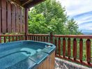 Twin hot tubs with a view - The lower deck has not one, but two hot tubs, so that everyone gets a chance to luxuriate in the steamy jets of water. The view of Mount LeConte adds to the relaxing vibe.